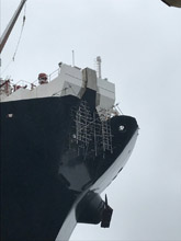 Suspended Scaffold on the bow of a massive oil tanker.