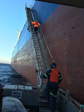 Boarding An Oil Tanker, just another place we install scaffolding.