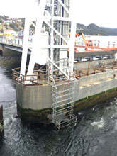 Cantilevered, Suspended Scaffold at Placentia Lift Bridge. (Under Construction)